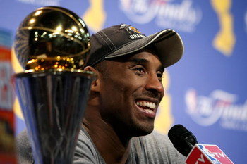 ORLANDO, FL - JUNE 14:  Kobe Bryant #24 of the Los Angeles Lakers smiles during the post game news conference after the Lakers defeated the Orlando Magic 99-86 to win the NBA Championship in Game Five of the 2009 NBA Finals on June 14, 2009 at Amway Arena