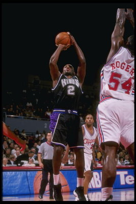 26 Nov 1997: Guard Mitch Richmond of the Sacramento Kings shoots the ball over forward Rodney Rodgers of the Los Angeles Clippers during a game at the Los Angeles Sports Arena in Los Angeles, California. The Clippers won the game 99-97.