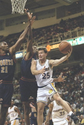 3 Dec 1996: Guard Mark Price of the Golden State Warriors tries to drive past forward Tom Hammonds of the Denver Nuggets at the San Jose Arena in San Jose, California. The Warriors won the game 114-99.