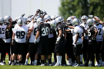ALAMEDA, CA - MAY 08:  The Oakland Raiders huddle together during the Raiders minicamp at the team's permanent training facility on May 8, 2009 in Alameda, California.  (Photo by Ezra Shaw/Getty Images)