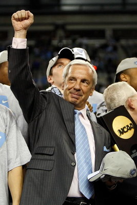 DETROIT - APRIL 06:  Head coach Roy Williams of the North Carolina Tar Heels celebrates following the Tar Heels 89-72 win against the Michigan State Spartans during the 2009 NCAA Division I Men's Basketball National Championship game at Ford Field on Apri