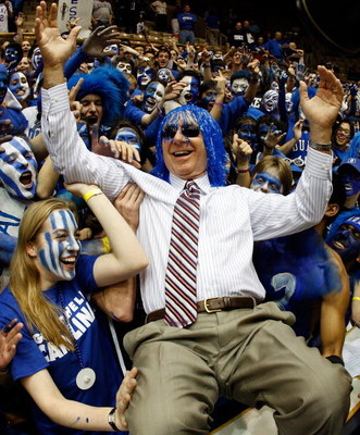 DURHAM, NC - FEBRUARY 11:  The Cameron Crazies of Duke clown around with Dick Vitale of ESPN before they face the North Carolina Tar Heels on February 11, 2009 at Cameron Indoor Stadium in Durham, North Carolina.  (Photo by Scott Halleran/Getty Images)