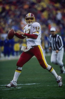 30 Nov 1997:  Gus Frerotte #12 of the Washington Redskins in action during a game against the St. Louis Rams at Jack Kent Cooke Stadium in Landover, Maryland. The Rams defeated the Redskins 23-20. Mandatory Credit: Doug Pensinger  /Allsport