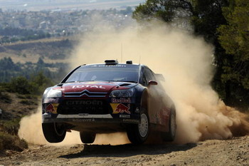 LOUTRAKI, GREECE - JUNE 12:  Sebastien Loeb of France and Daniel Elena of Monaco in action in the Citroen C4 Total during Leg 1 of the WRC Acropolis Rally of Greece on June 12, 2009 in Loutraki, Greece  (Photo by Massimo Bettiol/Getty Images)