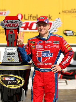 BROOKLYN, MI - JUNE 14:  Mark Martin, driver of the #5 CARQUEST/Kellogg's Chevrolet, celebrates in victory lane after winning the NASCAR Sprint Cup Series LifeLock 400 at Michigan International Speedway on June 14, 2009 in Brooklyn, Michigan.  (Photo by E