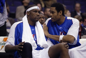LOS ANGELES - JANUARY 15:  (L-R) Elton Brand #1 of the Los Angeles Clippers listens to Michael Olowokandi #34 while seated on the bench during the game against the Minnesota Timberwolves on January 15, 2003 at Staples Center in Los Angeles, California.  T