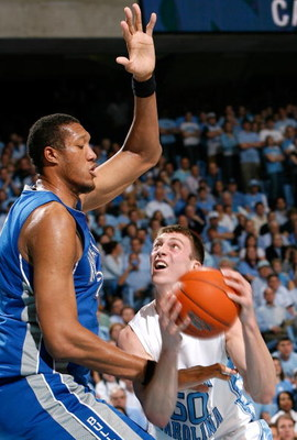 CHAPEL HILL, NC - JANUARY 09:  Tyler Hansbrough #50 of the North Carolina Tar Heels attacks the basket against Kenny George #22 of the North Carolina Asheville Bulldogs during the second half at the Dean E. Smith Center on January 9, 2008 in Chapel Hill,