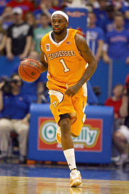 LAWRENCE, KANSAS - JANUARY 3:  Tyler Smith #1 of the Tennessee Volunteers drives downcourt during the game against the Kansas Jayhawks on January 3, 2009 at Allen Fieldhouse in Lawrence, Kansas. (Photo by: Jamie Squire/Getty Images)