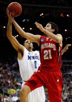 KANSAS CITY, MO - MARCH 21:  Greivis Vasquez #21 of the Maryland Terrapins lays up as shot against Shawn Taggart #0 of the Memphis Tigers in the first half during the second round of the NCAA Division I Men's Basketball Tournament at the Sprint Center on