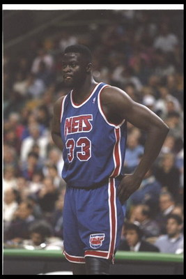 1 Dec 1995:  Center Yinka Dare of the New Jersey Nets looks on during a game against the Boston Celtics at the FleetCenter in Boston, Massachusetts.  The Nets won the game, 131-123. Mandatory Credit: Allsport  /Allsport