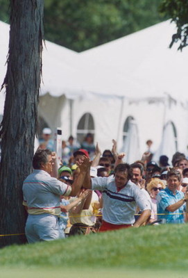 MEDINAH, ILLINOIS - 1990:  Hale Irwin of the USA celebrates victory with a lap of honour on the 18th hole during the 1990 US Open held at the Medinah Country Club, in Medinah, Illinois, USA. (Photo by Stephen Munday/Getty Images)