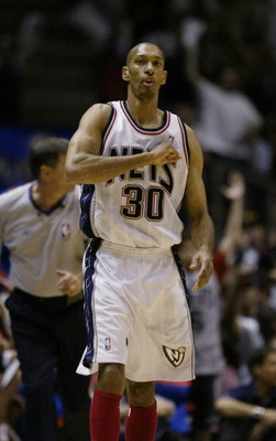 EAST RUTHERFORD, NJ - MAY 16:  Kerry Kittles #30 of the New Jersey Nets on the court in Game six of the Eastern Conference Semifinals during the 2004 NBA Playoffs against the Detroit Pistons at Continental Airlines Arena on May 16, 2004 in East Rutherford