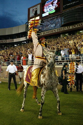 TALLAHASSEE, FL - SEPTEMBER 05:  FSU mascot Chief Osceola and his horse Renegade of the Florida State Seminoles pumps up the crowd to start the game against the Miami Hurricanes at Doak Campbell Stadium on September 5, 2005 in Tallahassee, Florida.  (Phot