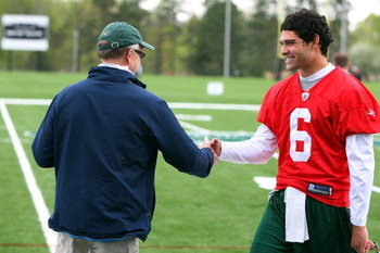 FLORHAM PARK, NJ - MAY 02:  Quarterback Mark Sanchez #6 of the New York Jets talks with team owner Woody Johnson during minicamp on May 2, 2009 at the Atlantic Health Jets Training Center in Florham Park, New Jersey.  (Photo by Jim McIsaac/Getty Images)