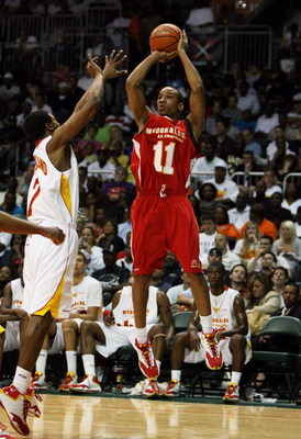 CORAL GABLES, FL - APRIL 01:  Avery Bradley Jr. #11 of the West Team shoots over Dexter Strickland #7 of the East Team in the 2009 McDonald's All American Men's High School Basketball Game at BankUnited Center on April 1, 2009 in Coral Gables, Florida.  (