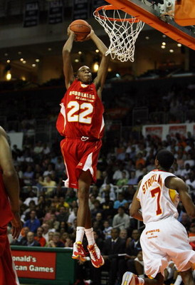 CORAL GABLES, FL - APRIL 01:  John Henson #22 of the West Team dunks over Dexter Strickland #7 of the East Team in the 2009 McDonald's All American Men's High School Basketball Game at BankUnited Center on April 1, 2009 in Coral Gables, Florida.  (Photo b