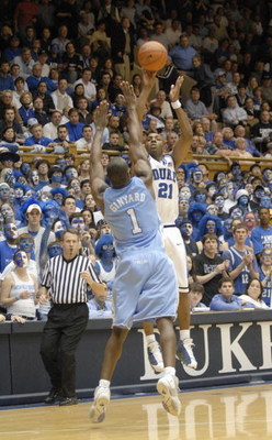 DURHAM, NC - FEBRUARY 7: DeMarcus Nelson #21 of the Duke University Blue Devils makes a jumpshot overMarcus Ginyard #1 of the North Carolina Tar Heels during the game on February 7, 2007 at Cameron Indoor Stadium in Durham, N.C. North Carolina won 79-73.