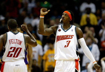 CHARLOTTE, NC - MARCH 31:  Gerald Wallace #3 and Raymond Felton #20 of the Charlotte Bobcats react after a play during their game against the Los Angeles Lakers at Time Warner Cable Arena on March 31, 2009 in Charlotte, North Carolina.  NOTE TO USER: User