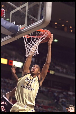 29 Nov 1995:  Center Tim Duncan #21 of the Wake Forest Demon Deacons slams the ball at The Palace of Auburn Hills, Michigan, during the game against the Oklahoma State Cowboys at the Great eight tournament.  Wake Forest advanced to the Final Four.  Mandat