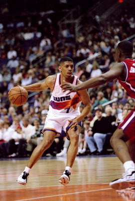 14 Feb 1997:  Guard Kevin Johnson of the Phoenix Suns in action with the ball during a game against the Los Angeles Clippers at the America West Arena in Phoenix, Arizona.  The Suns won the game 110-93. Mandatory Credit: Jed Jacobsohn  /Allsport