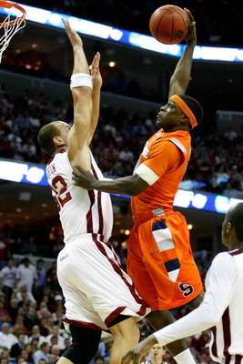 MEMPHIS, TN - MARCH 27:  Jonny Flynn #10 of the Syracuse Orange goes up for a dunk over Taylor Griffin #32 of the Oklahoma Sooners in the second half during the NCAA Men's Basketball Tournament South Regionals at the FedExForum on March 27, 2009 in Memphi