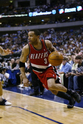 DALLAS - MAY 4:  Damon Stoudamire #3 of the Portland Trail Blazers drives in Game seven of the Western Conference Quarterfinals against the Dallas Mavericks during the 2003 NBA Playoffs at American Airlines Center on May 5, 2003 in Dallas, Texas.  The Mav