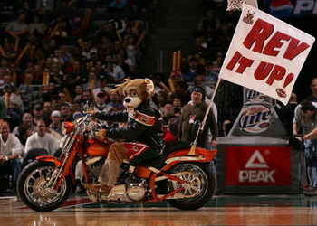 MILWAUKEE - MARCH 07: Bango, the mascot of the Milwaukee Bucks, rides a motorcycle during a break in the action between the Bucks and the Portland Trail Blazers on March 7, 2008 at the Bradley Center in Milwaukee, Wisconsin. The Trail Blazers defeated the