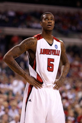 INDIANAPOLIS - MARCH 27:  Earl Clark #5 of the Louisville Cardinals looks on against the Arizona Wildcats during the third round of the NCAA Division I Men's Basketball Tournament at the Lucas Oil Stadium on March 27, 2009 in Indianapolis, Indiana.  (Phot