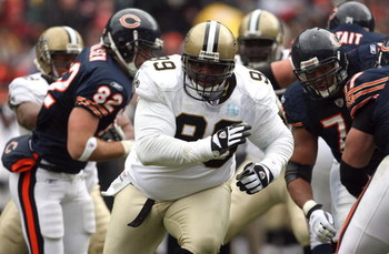 CHICAGO - DECEMBER 30:  Hollis Thomas #99 of the New Orleans Saints rushes the passer against the Chicago Bears at Soldier Field on December 30, 2007 in Chicago, Illinois.  (Photo by Jonathan Daniel/Getty Images)
