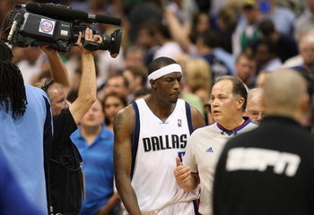 DALLAS - MAY 09:  Forward Josh Howard #5 of the Dallas Mavericks talks with NBA referee Mark Wunderlich after a 106-105 loss against the Denver Nuggets in Game Three of the Western Conference Semifinals during the 2009 NBA Playoffs at American Airlines Ce