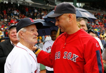 BOSTON - SEPTEMBER 28: Manager Terry Francona of the Boston Red Sox chats with Boston Red Sox great Johnny Pesky during a ceremony where Pesky's No. 6 was retired prior to a baseball game against the New York Yankees at Fenway Park September 28, 2008 in B