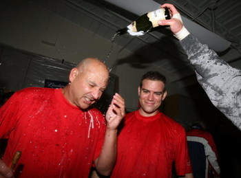 BOSTON - OCTOBER 06:  Manager Terry Francona #47 and Theo Epstein of the Boston Red Sox celebrate in the clubhouse after the Red Sox scored a run in the bottom of the ninth inning to win Game Four of the American League Championship Series on October 6, 2