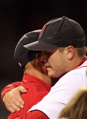 BOSTON - SEPTEMBER 23:  Jonathan Papelbon #58 of the Boston Red Sox is congratulated by manager Terry Francona #47 after the 5-4 win over the Cleveland Indians clinched the Red Sox the Wild Card on September 23, 2008 at Fenway Park in Boston, Massachusett