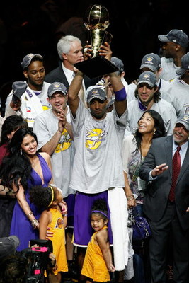 ORLANDO, FL - JUNE 14:  Kobe Bryant #24 of the Los Angeles Lakers celebrates with the Larry O'Brien Trophy after defeating the Orlando Magic 99-86 in Game Five of the 2009 NBA Finals on June 14, 2009 at Amway Arena in Orlando, Florida.  NOTE TO USER:  Use