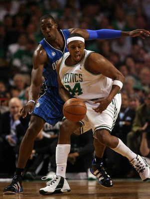 BOSTON - MAY 17:  Paul Pierce #34 of the Boston Celtics loses control of the ball as Dwight Howard #12  of the Orlando Magic defends in Game Seven of the Eastern Conference Semifinals during the 2009 NBA Playoffs at TD Banknorth Garden on May 17, 2009 in