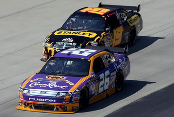 DOVER, DE - MAY 31: Jamie McMurray, driver of the #26 Crown Royal Ford leads Elliott Sadler, driver of the #19 Stanley Tools Dodge during the NASCAR Sprint Cup Series Autism Speaks 400 at Dover International Speedway on May 31, 2009 in Dover, Delaware.  (