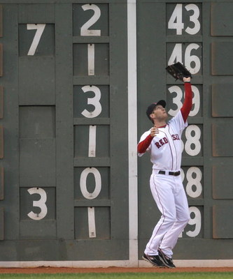 BOSTON - JUNE 11: Jason Bay #44 of the Boston Red Sox catches a fly ball against the New York Yankees at Fenway Park on June 11, 2009 in Boston, Massachusetts.  (Photo by Jim Rogash/Getty Images)
