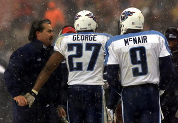 17 Dec 2000:  Head coach Jeff Fisher of the Tennessee Titans congratulates Quarterback Steve McNair #9  and Eddie George #27 after a touchdown during Sunday's game against the Cleveland Browns at Cleveland Browns Stadium in Cleveland, Ohio.  Digital Image