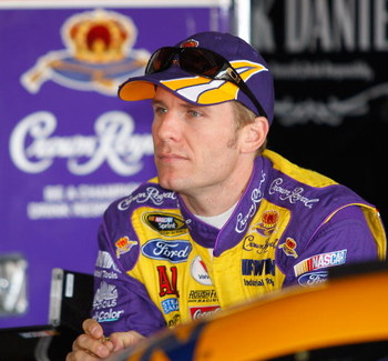 BROOKLYN, MI - JUNE 12: Jamie McMurray, driver of the #26 Crown Royal Ford sits in the garage prior to practice for the NASCAR Sprint Cup Series LifeLock 400 at Michigan International Speedway on June 12, 2009 in Brooklyn, Michigan.  (Photo by Geoff Burke