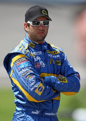 BROOKLYN, MI - JUNE 12: Elliott Sadler, driver of the #19 Best Buy Dodge, stands on the grid during qualifying for the NASCAR Sprint Cup Series LifeLock 400 at Michigan International Speedway on June 12, 2009 in Brooklyn, Michigan.  (Photo by Jonathan Dan
