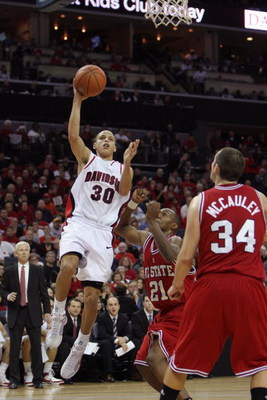 CHARLOTTE, NC - DECEMBER 6:  Stephen Curry #30 of the Davidson Wildcats goes up with the ball during the game against the North Carolina State Wolfpack at Time Warner Cable Arena on December 6, 2008 in Charlotte, North Carolina. (Photo by Streeter Lecka/G