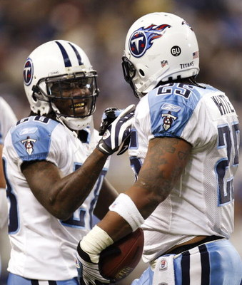 DETROIT , MI - NOVEMBER 27:  LenDale White #25 of the Tennessee Titans celebrates a second quarter touchdown with Chris Johnson #28 while playing the Detroit Lions on November 27, 2008 at Ford Field in Detroit, Michigan.  (Photo by Gregory Shamus/Getty Im