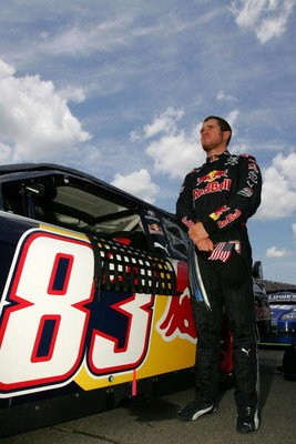 BROOKLYN, MI - JUNE 14:  Brian Vickers, driver of the #83 Red Bull Toyota, prepares to drive before the NASCAR Sprint Cup Series LifeLock 400 at Michigan International Speedway on June 14, 2009 in Brooklyn, Michigan.  (Photo by Todd Warshaw/Getty Images f