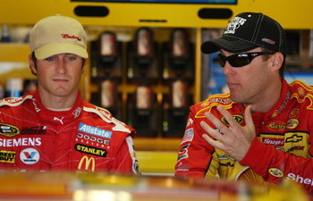 BROOKLYN, MI - JUNE 14: Kasey Kahne (L), driver of the #9 Budweiser Dodge, chats with Kevin Harvick, driver of the #29 Shell/Pennzoil Chevrolet before practice for the NASCAR Sprint Cup Series Lifelock 400 at the Michigan International Speedway on June 14