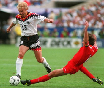 2 JUL 1994:   RUDY VOELLER OF GERMANY AVOIDS THE TACKLE OF GEORGES GRUN OF BELGIUM  DURING THE FIRST-HALF AT SOLDIER FIELD IN CHICAGO, ILLINOIS.  VOLLER SCORED TWO GOALS AND ASSISTED ON A THIRD AS GERMANY LED BELGIUM, 3-1 AT THE HALF. Mandatory Credit: Ch