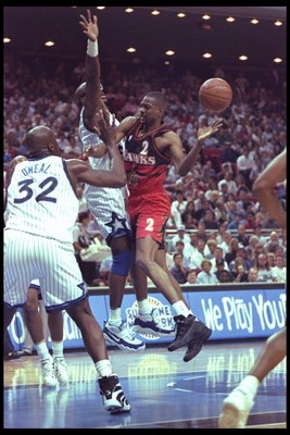 18 Apr 1996:  Stacey Augmon of the Atlanta Hawks moves the ball against the Orlando Magic during a game played at the Orlando Arena in Orlando, Florida.  The Magic won the game, 119-104. Mandatory Credit: ALLSPORT USA  /Allsport