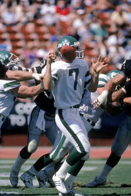 LOS ANGELES, CA - SEPTEMBER 8:  Quarterback Ken O'Brien #7 of the New York Jets has the ball knocked loose during a game against the Los Angeles Raiders at the Los Angeles Memorial Coliseum on September 8, 1985 in Los Angeles, California.  The Raiders won
