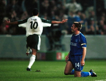 28 Sep 2000:  Ionel Gane of St Gallen celebrates as a dejected Captain Greama Le Saux of Chelsea during the UEFA Cup First leg second round match between St Gallen and Chelsea played at the Hardturm Stadium in Zurich. Mandatory Credit: Graham Chadwick/ALL