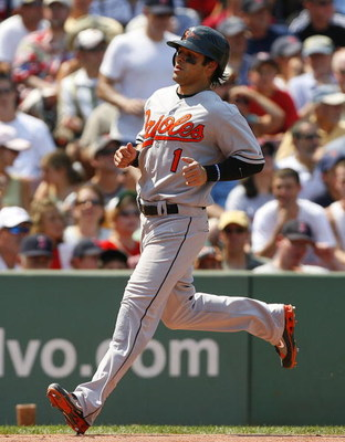 BOSTON - AUGUST 2:  Brian Roberts #1 of the Baltimore Orioles scores a run against the Boston Red Sox on August 2, 2007 at Fenway Park in Boston, Massachusetts. (Photo by Jim Rogash/Getty Images)