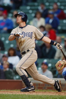 CHICAGO - AUGUST 12:  Mark Loretta #8 of the San Diego Padres watches the flight of the ball as he follows through on a swing during the game against the Chicago Cubs at Wrigley Field on August 12, 2004 in Chicago, Illinois.  The Padres won 5-4. (Photo by